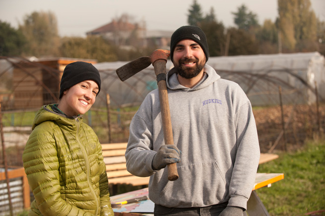 A man and a woman working at a Solid Ground community garden near Seattle
