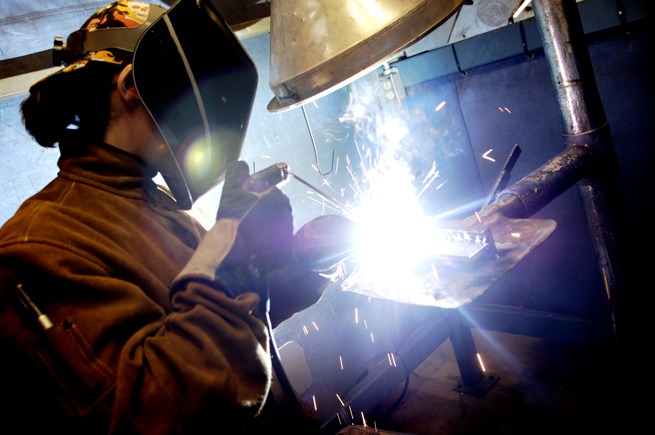 Man welding in Renton, Washington