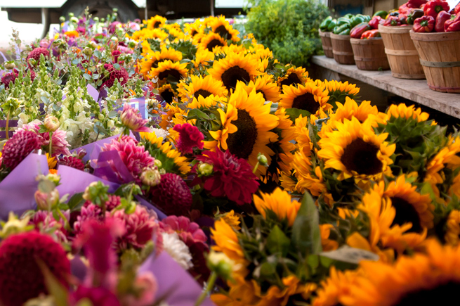 Flowers and vegetables for sale at a Saint Paul farmers market