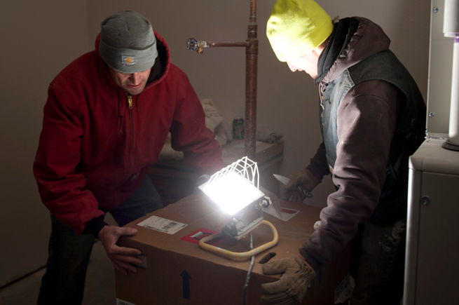 Two men working on a installation in a home