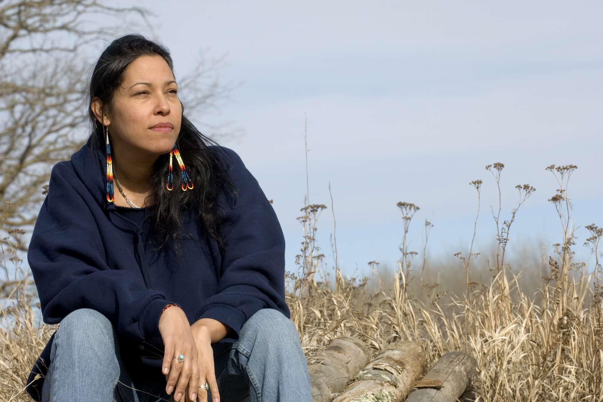 Native woman in a prairie setting