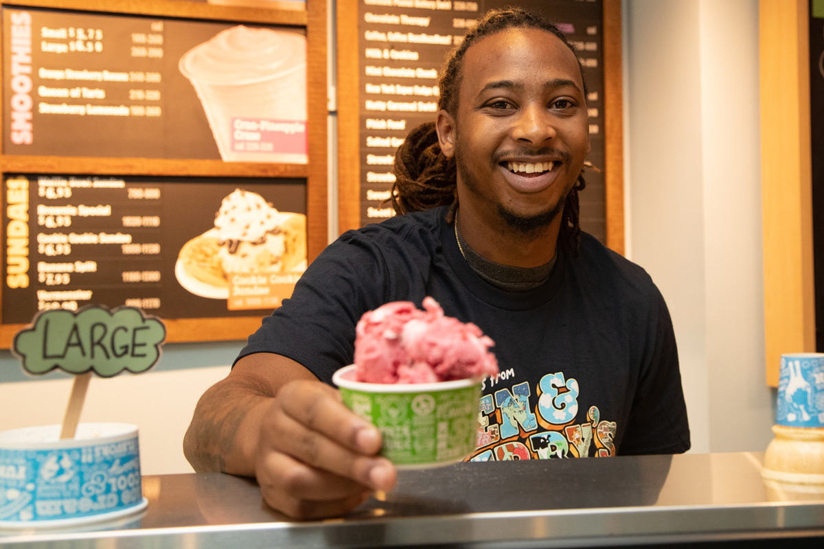 Young man serving ice cream at a Baskin & Robbins